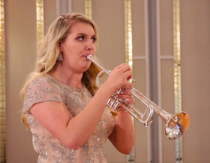Photo of Katherine playing at her recent recital, with her old embouchure